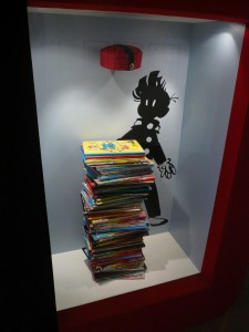 'Spirou passed from hand to hand' installation with stack of albums