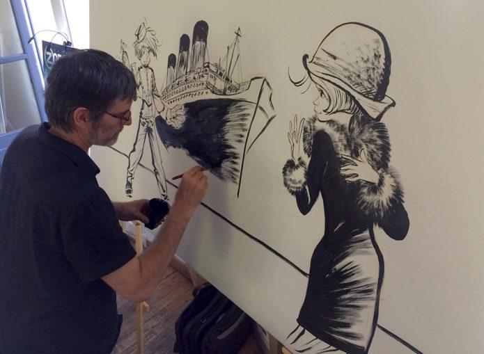 Laurent Verron drawing Ptirou mural (photo from dupuis.com)